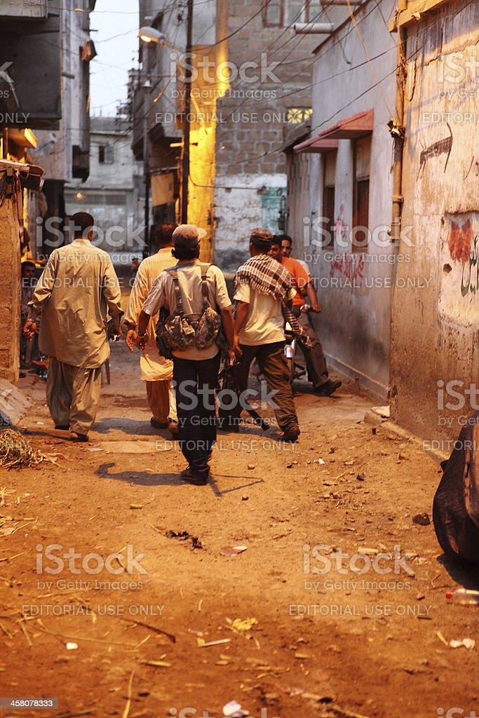 'City of God, Armed Mafia members in Karachi Slums' stock photo