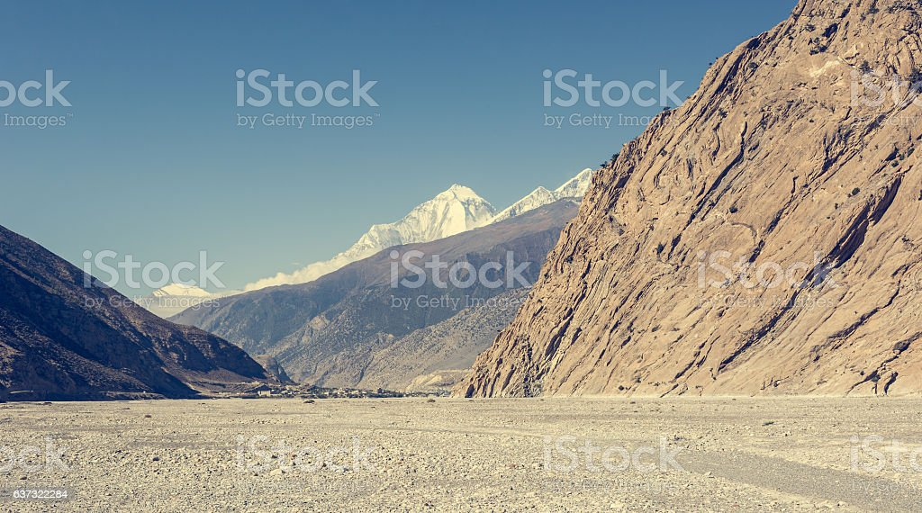 City of Jomson under snow covered peaks. stock photo