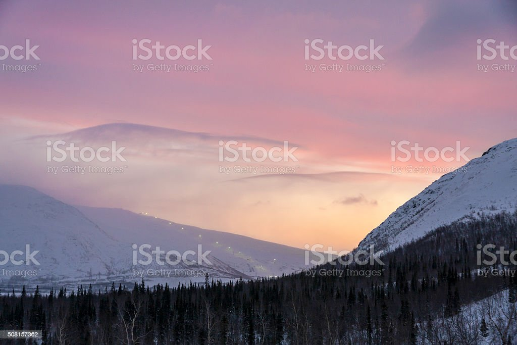 city of Kirovsk in the winter on sunset stock photo