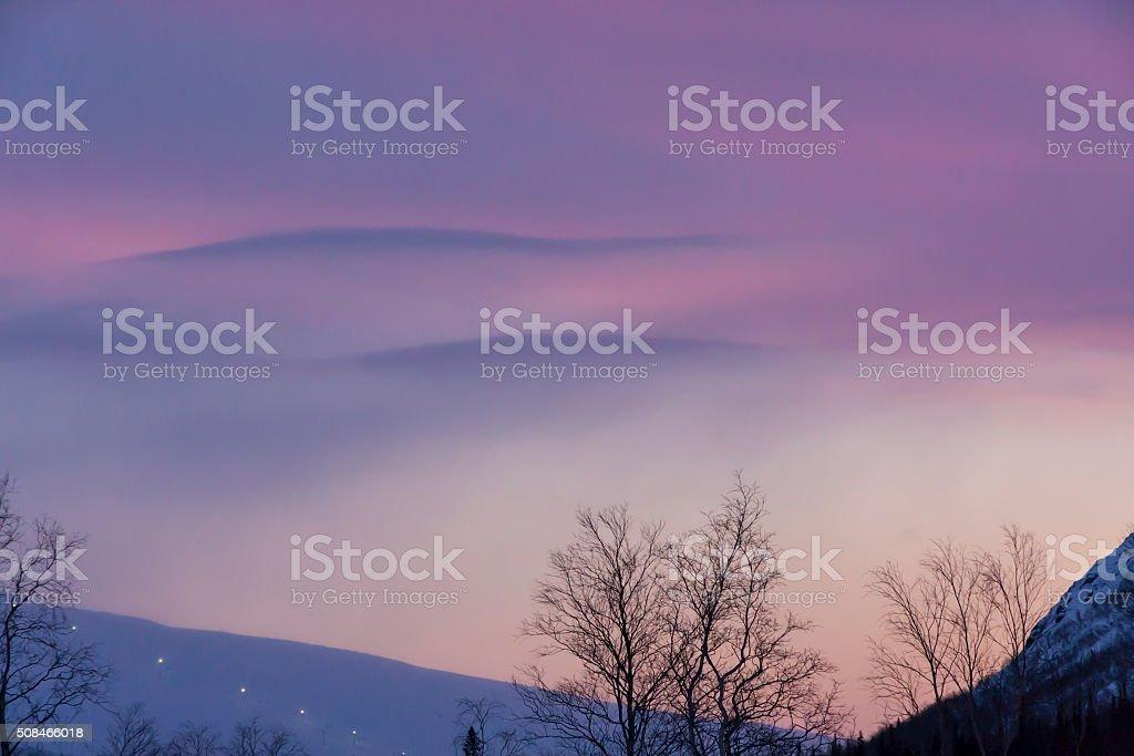 city of Kirovsk in the winter on sunset stock photo