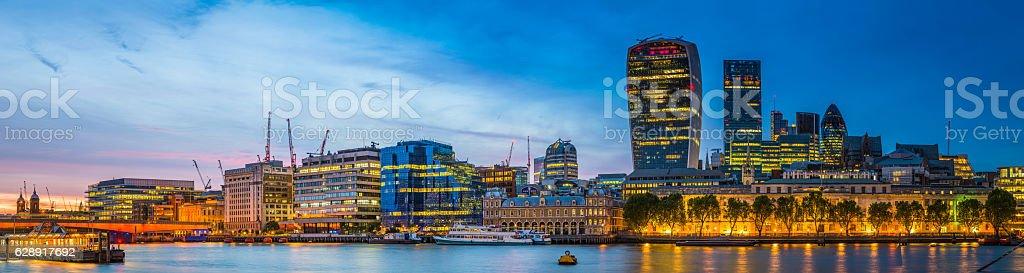 City of London Square Mile skyscrapers illuminated Thames sunset panorama stock photo