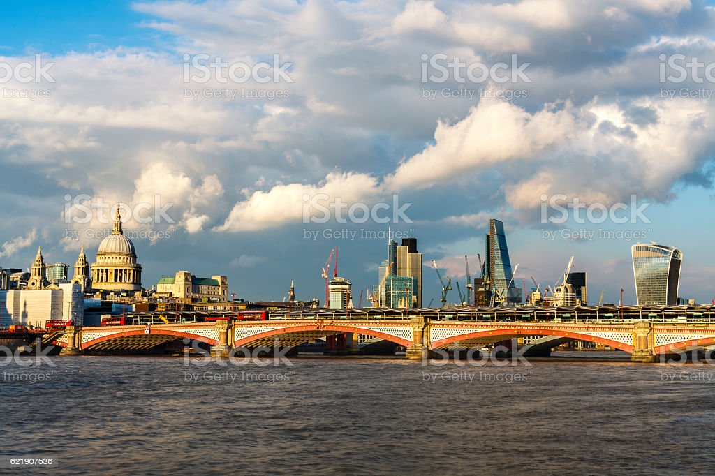 City of London sunset with clouds, orange sunset stock photo
