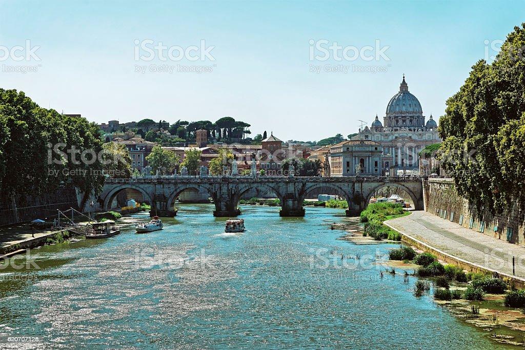 City of Rome skyline and Ponte Sant Angelo Bridge stock photo