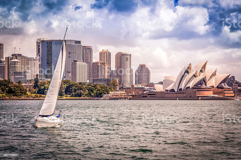 City of Sydney Cityscape with Opera House and Sailing Boat stock photo