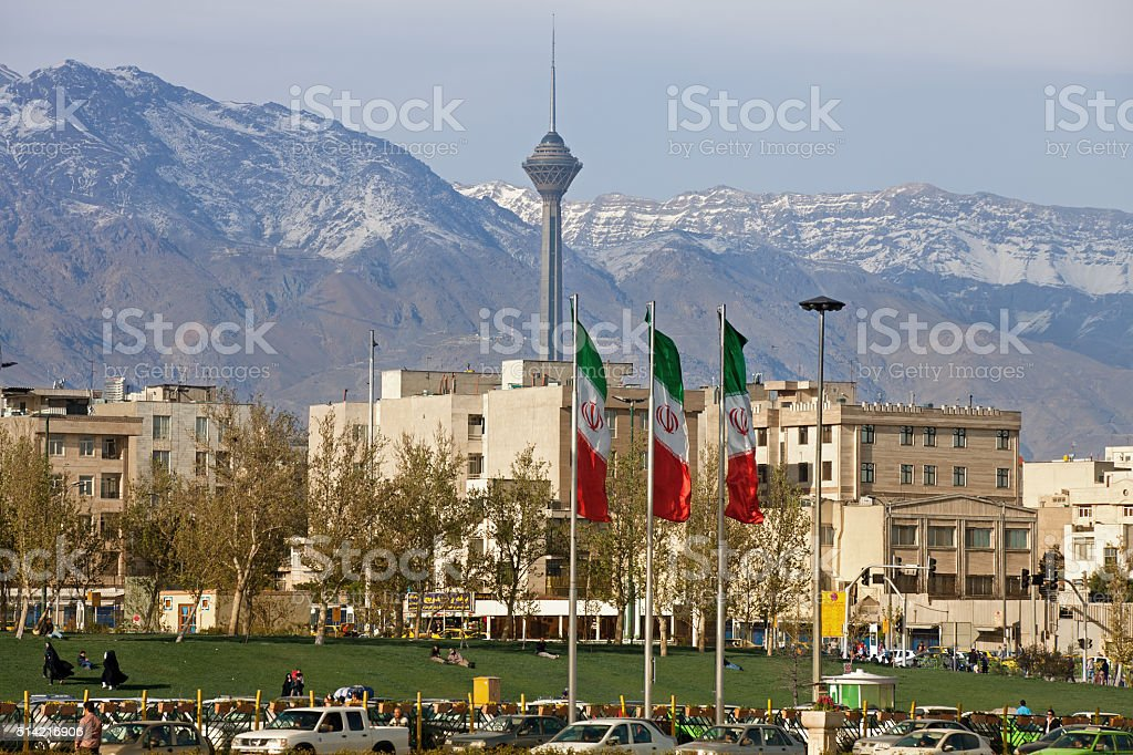 City of Tehran with Milad Tower and Iran Flags stock photo