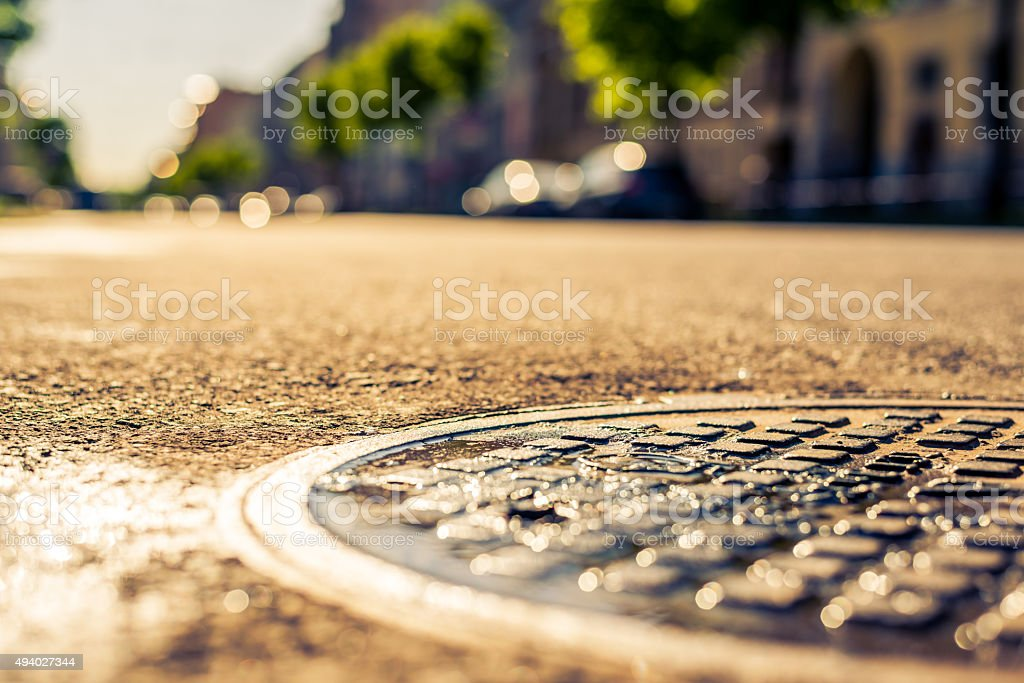 City on a sunny day, a quiet street with trees stock photo