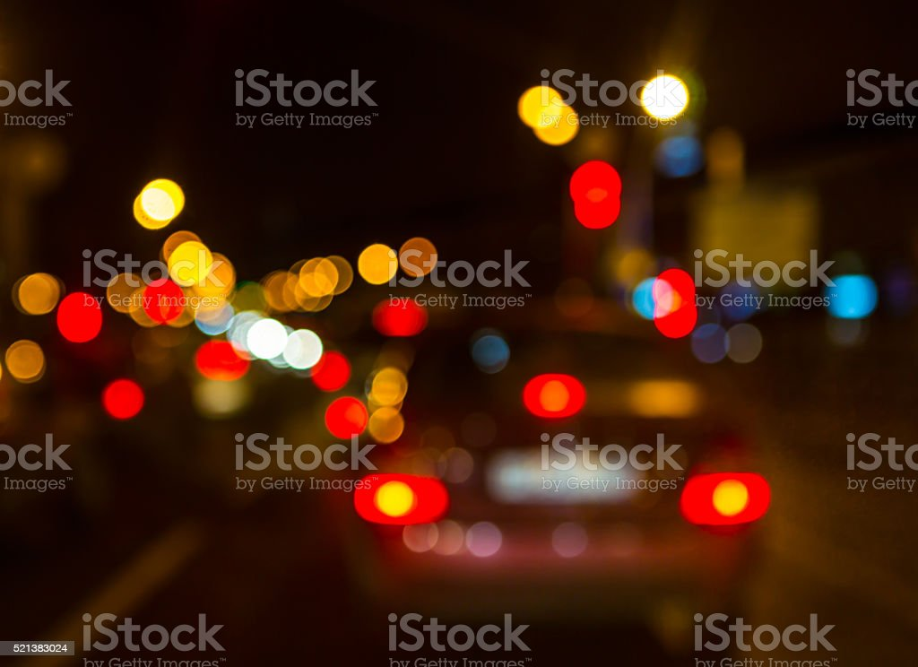 City out of focus. Road at night with car. stock photo