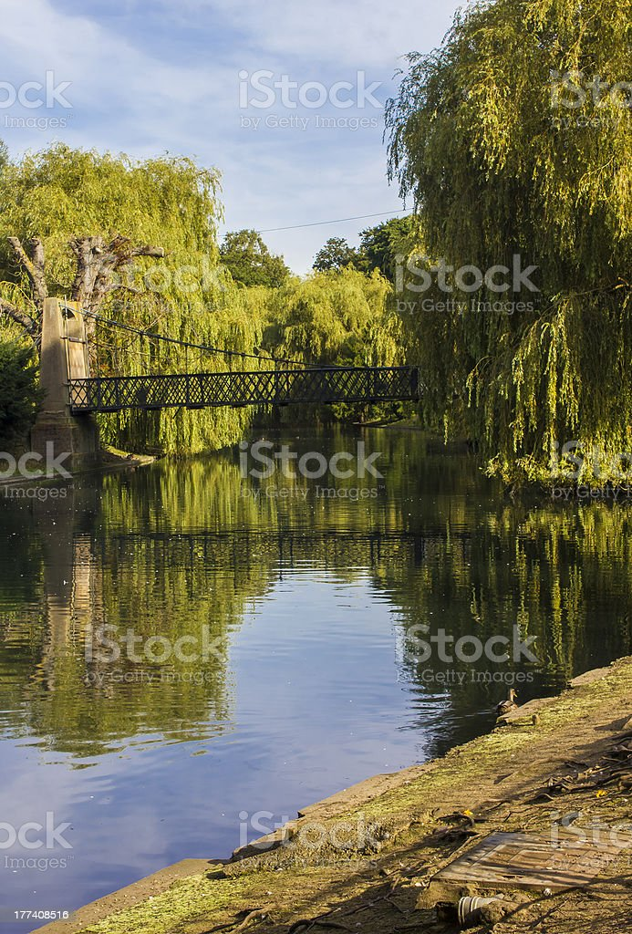 City park river bridge stock photo
