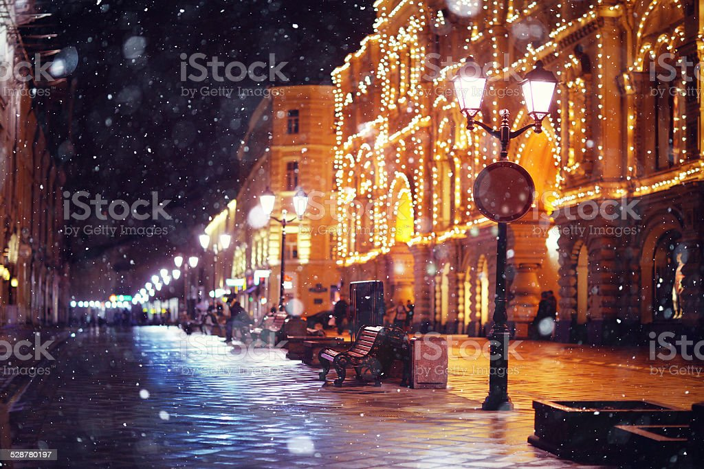 city pedestrian street night city lights stock photo