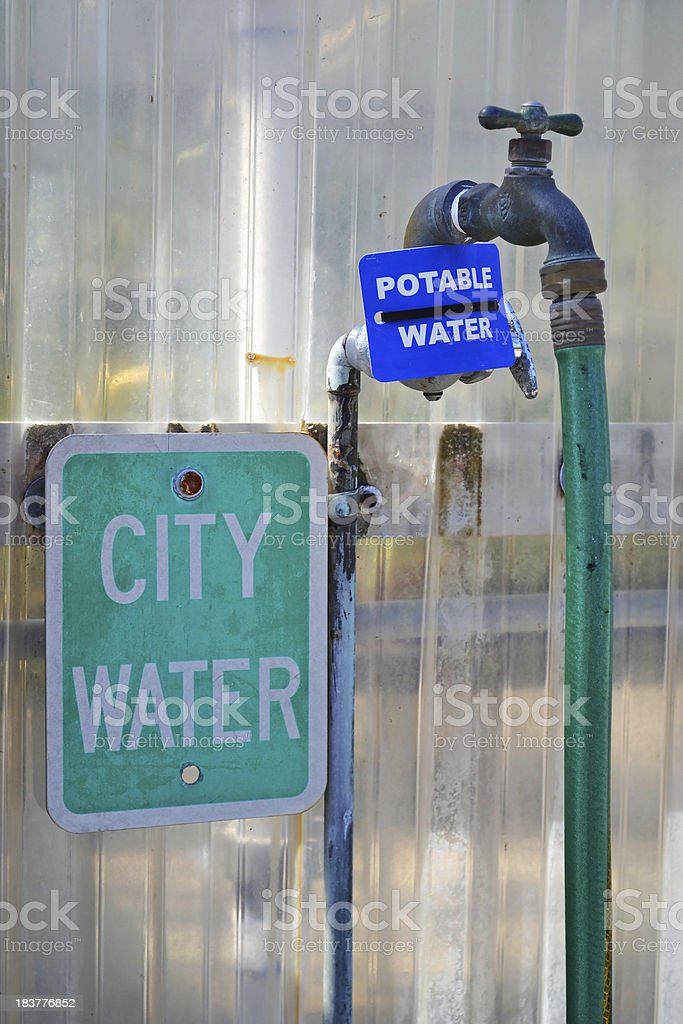 City / Potable Water Signs Next to Faucet and Hose stock photo