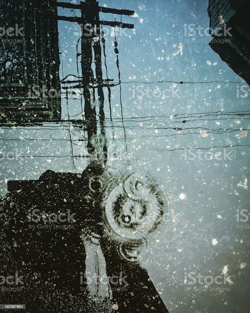 City reflection on rain puddle royalty-free stock photo