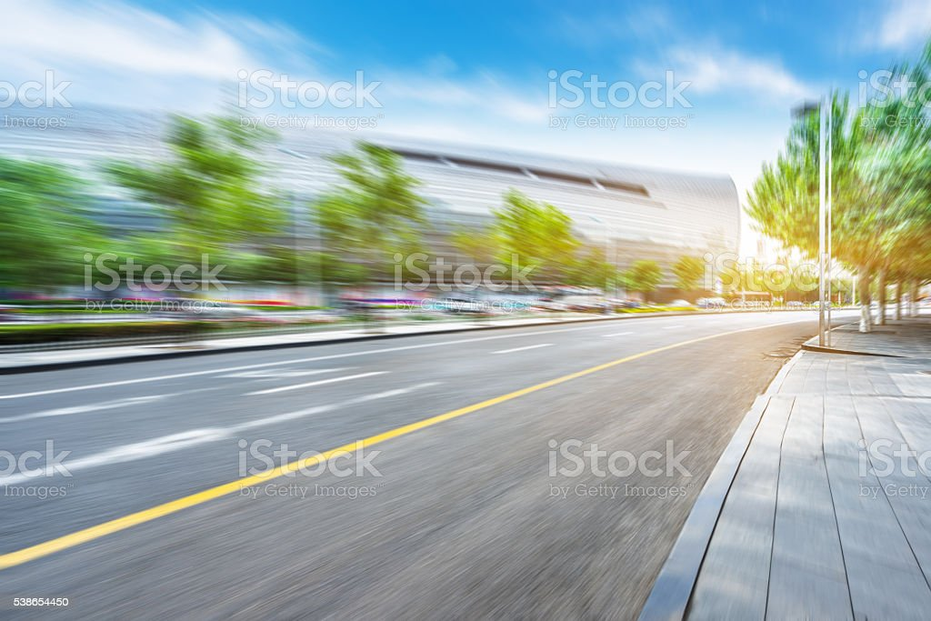 city road near modern building stock photo