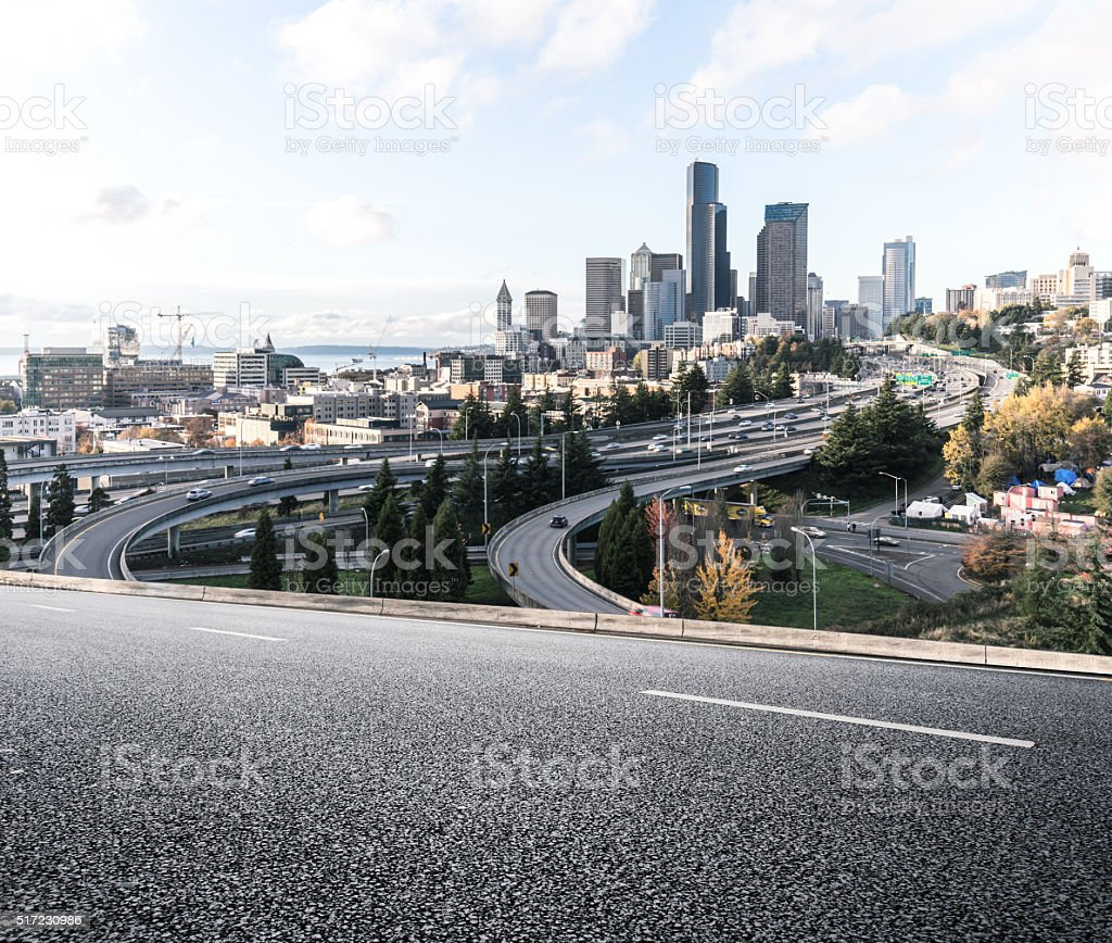 city road with cityscape and skyline of seattle stock photo