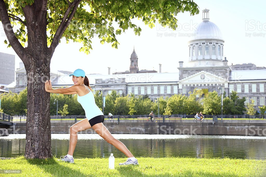 City runner workout woman stretching stock photo