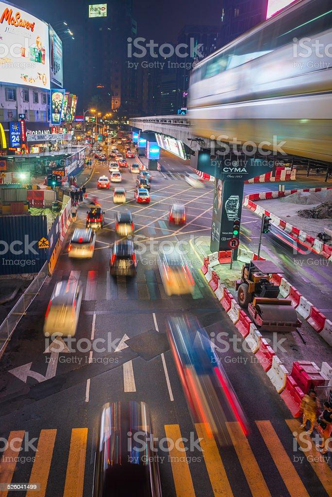 City rush hour traffic futuristic neon night Kuala Lumpur Malaysia stock photo