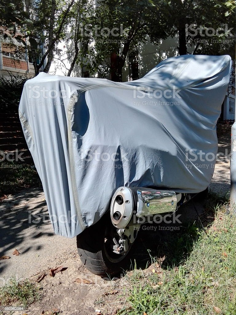 City Scooter with grey PVC cover on stock photo