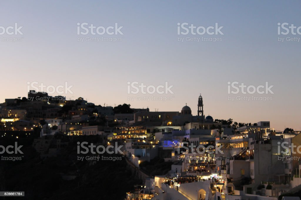City Skyline at Dusk Near Night Time in Greek Island of Santorini stock photo