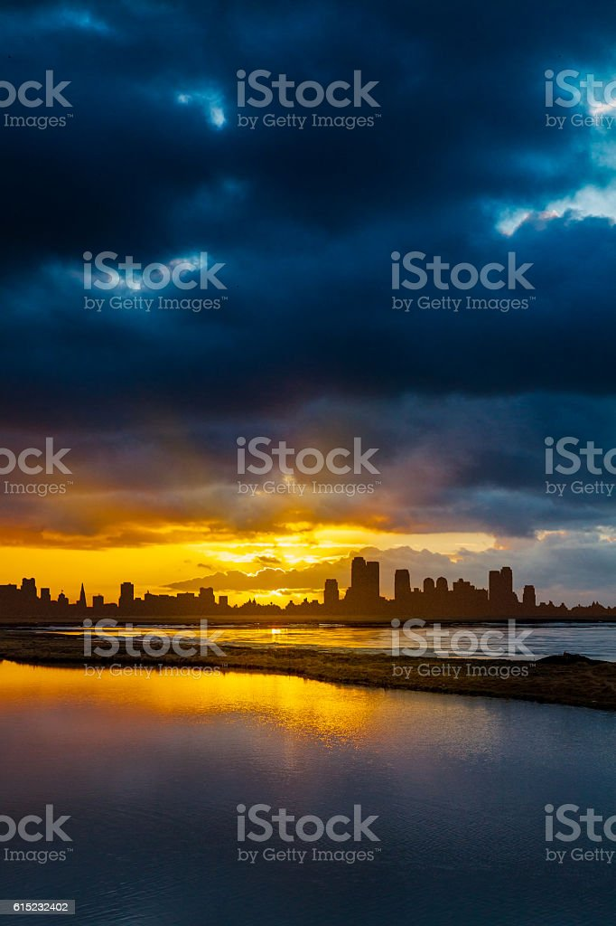 City Skyline  at Sunrise or Sunset with Water in Foreground stock photo