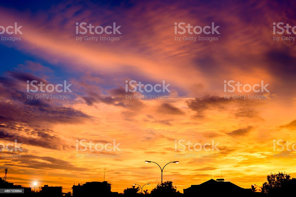 City skyline silhouetted against a blue sunset stock photo