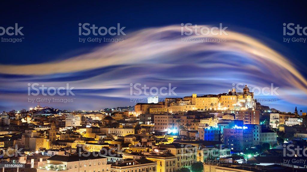 City skyline with smoke illuminated by lights stock photo