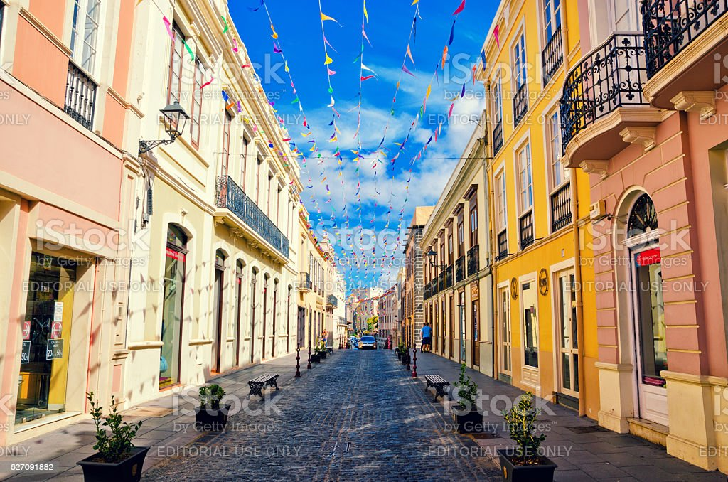 City street in La Orotava decorated with colorful flags. stock photo