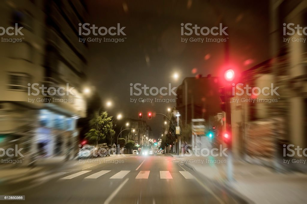 City street night view, red and green traffic lights, raindrops. stock photo