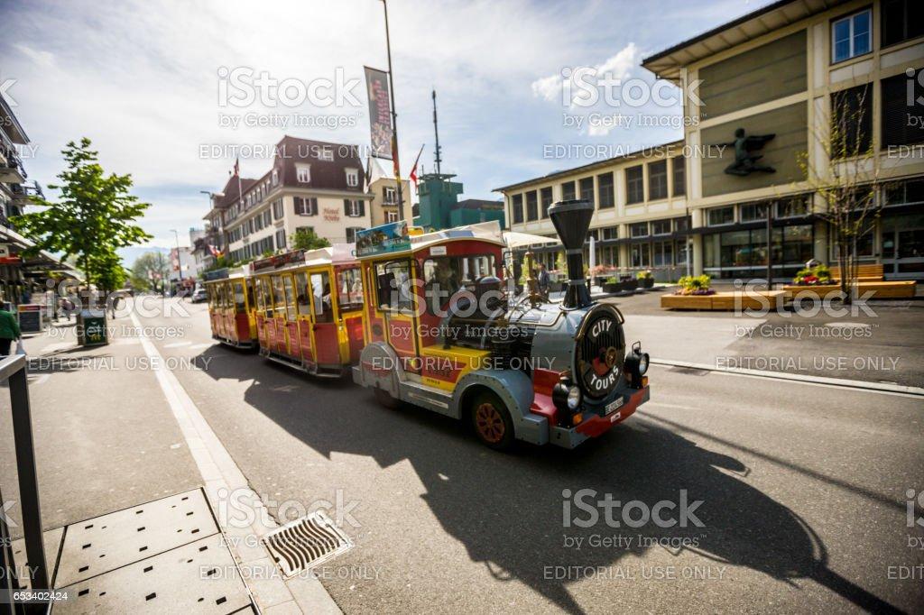 City tours train in Interlaken, Switzerland stock photo
