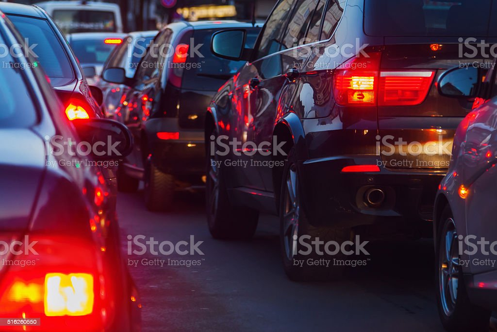 city traffic at dusk stock photo