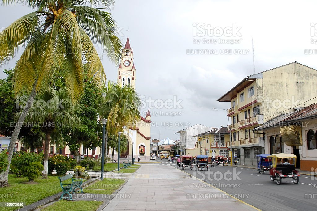 City traffic near Plaza de Armas in Iquitos, Peru. stock photo