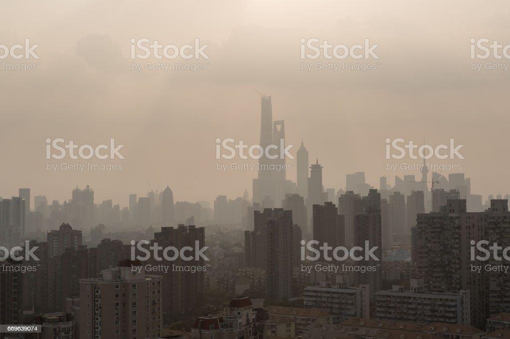 City under siege, Shanghai air pollution stock photo