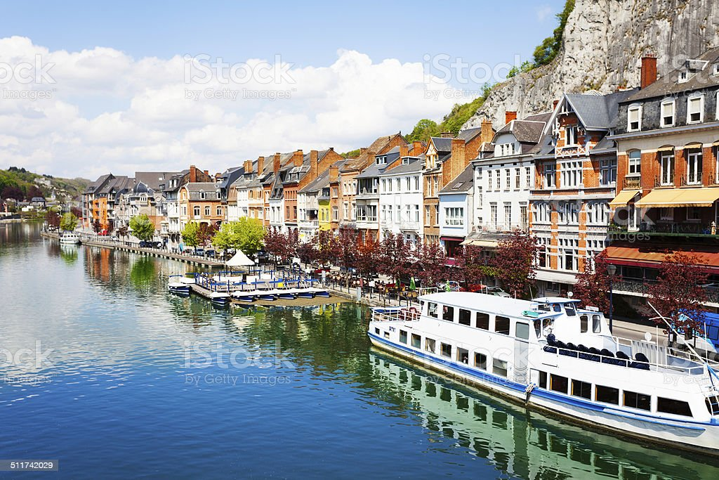 City view of Dinant on Meuse river with ships stock photo