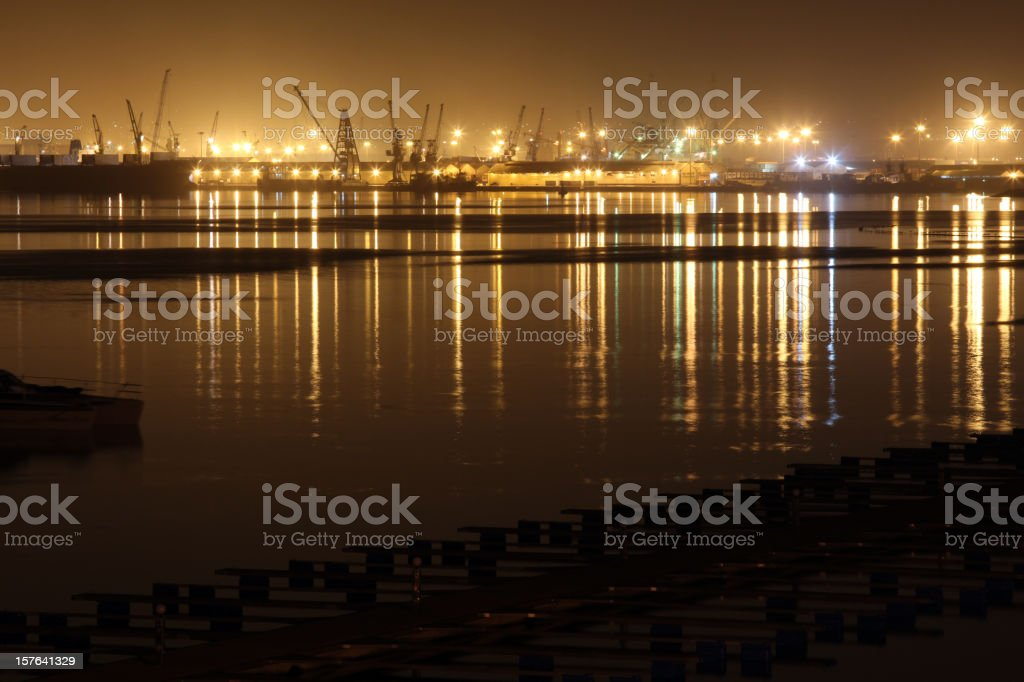 CIty view of harbor in Luanda, Angola at night stock photo