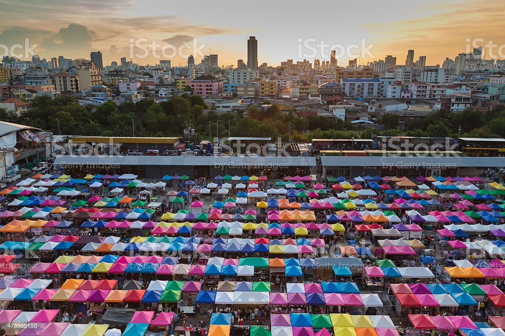City weekend market aerial view with multi colour umbrella stock photo