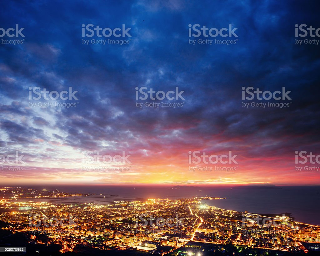 city with a night on the beach stock photo