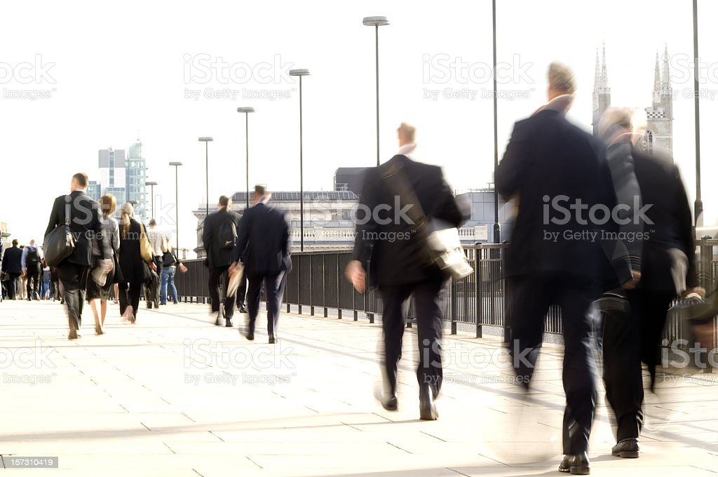 City workers commuters walking with movement blur, London UK stock photo