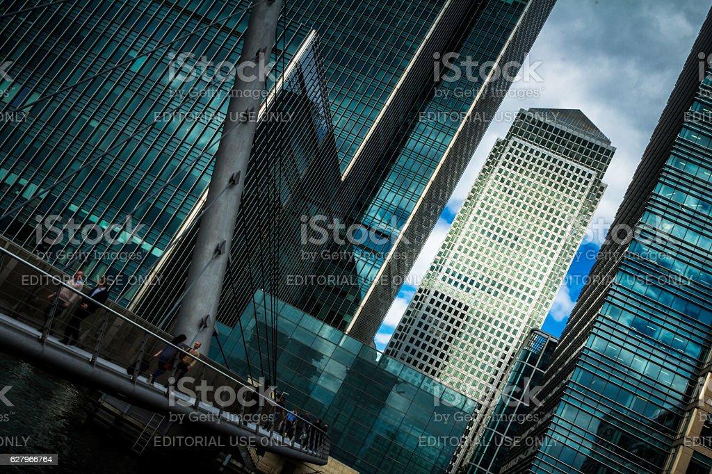 City workers walking across bridge at Canary Wharf, London, UK stock photo