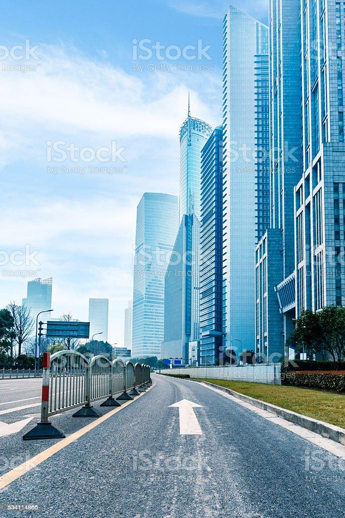 city,building,road under blue sky stock photo