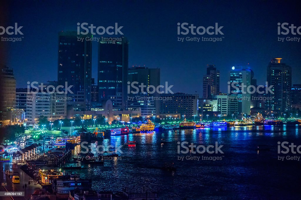 Cityscape and Skyline of Dubai Creek Waterfront at Night, UAE stock photo