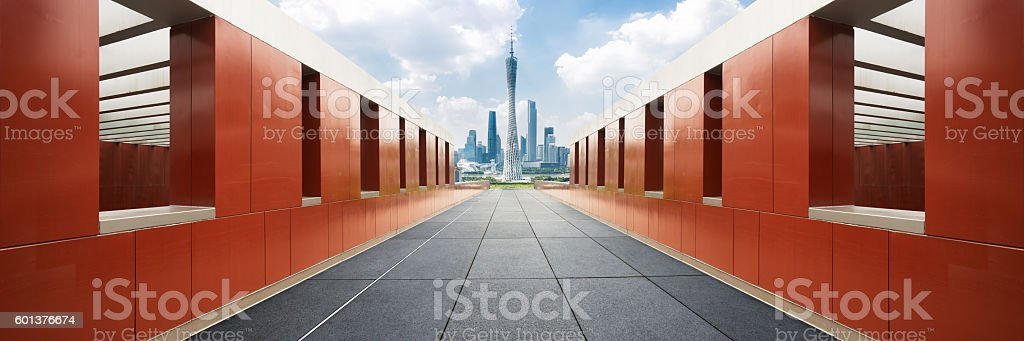 cityscape and skyline of guangzhou from empty brick floor stock photo