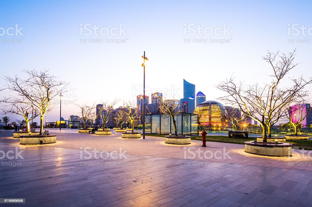 cityscape and skyline of hangzhou new city from empty square stock photo