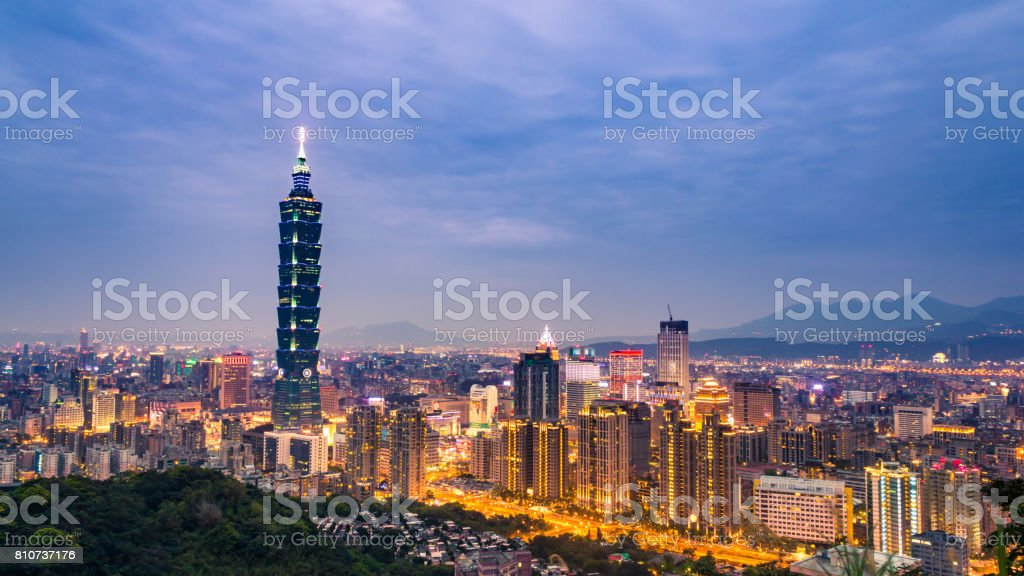 cityscape and skyline of modern city at night stock photo