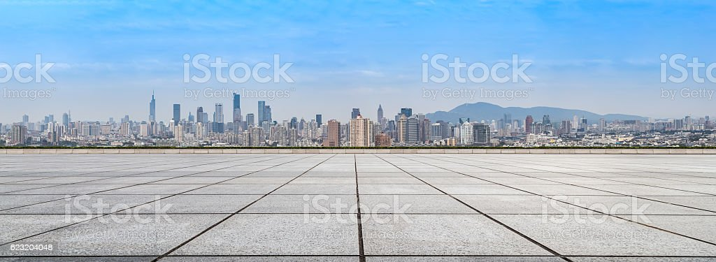 cityscape and skyline of nanjing from empty brick floor stock photo