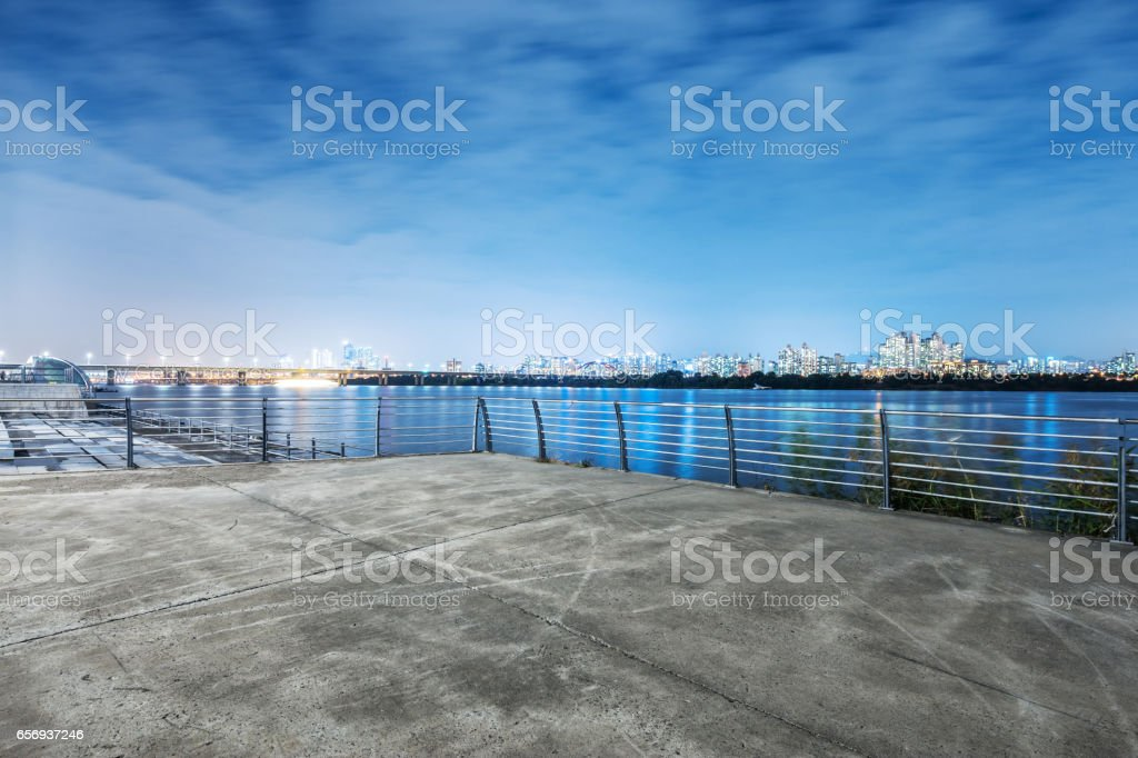 cityscape and skyline of seoul at night from empty floor stock photo