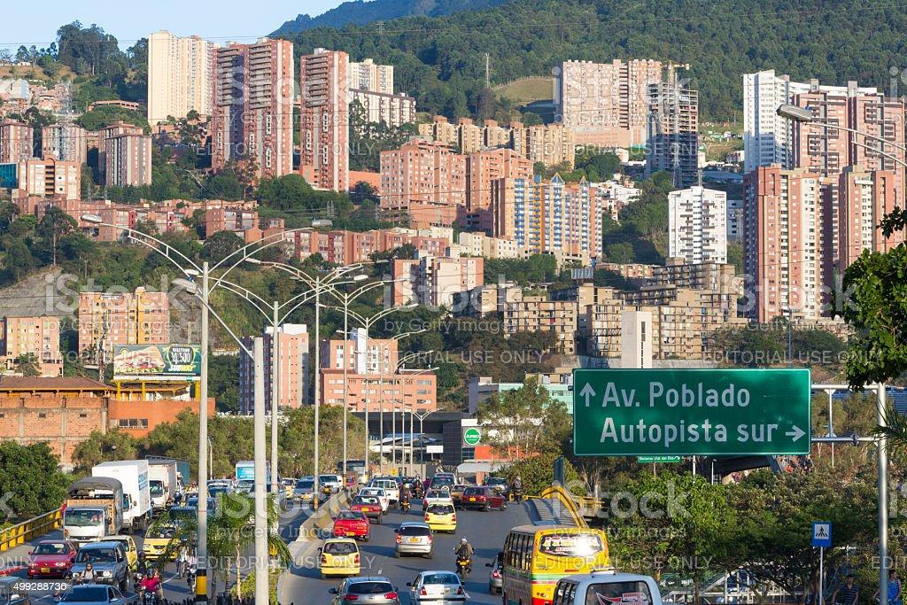 Cityscape and traffic sign road to Poblado, Medellin stock photo