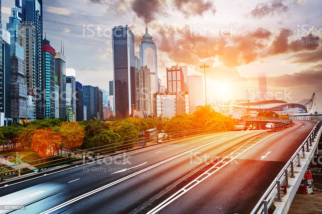 cityscape and traffic trails on the road of modern city stock photo