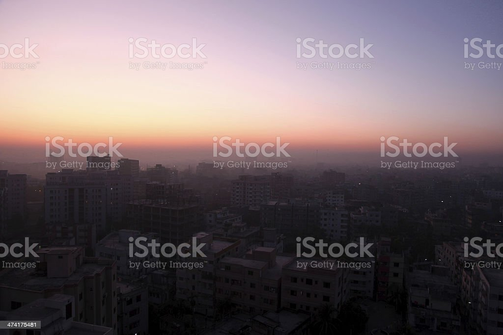 Cityscape at dawn with dramatic sky stock photo