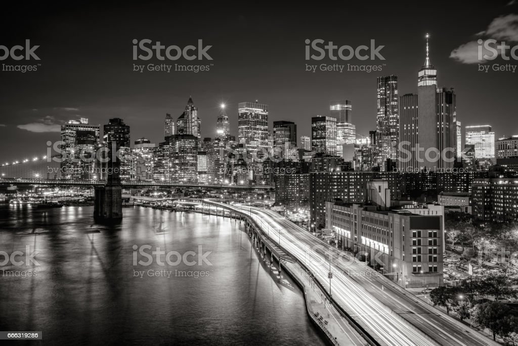 Cityscape at night of Lower Manhattan Financial District with illuminated skyscrapers. New York City (Black & White) stock photo