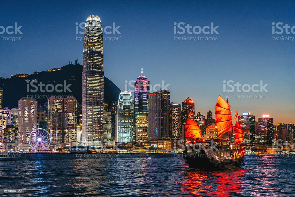 Cityscape Hong Kong and Junkboat at Twilight stock photo
