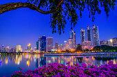 Cityscape image of Benchakitti Park at twilight time