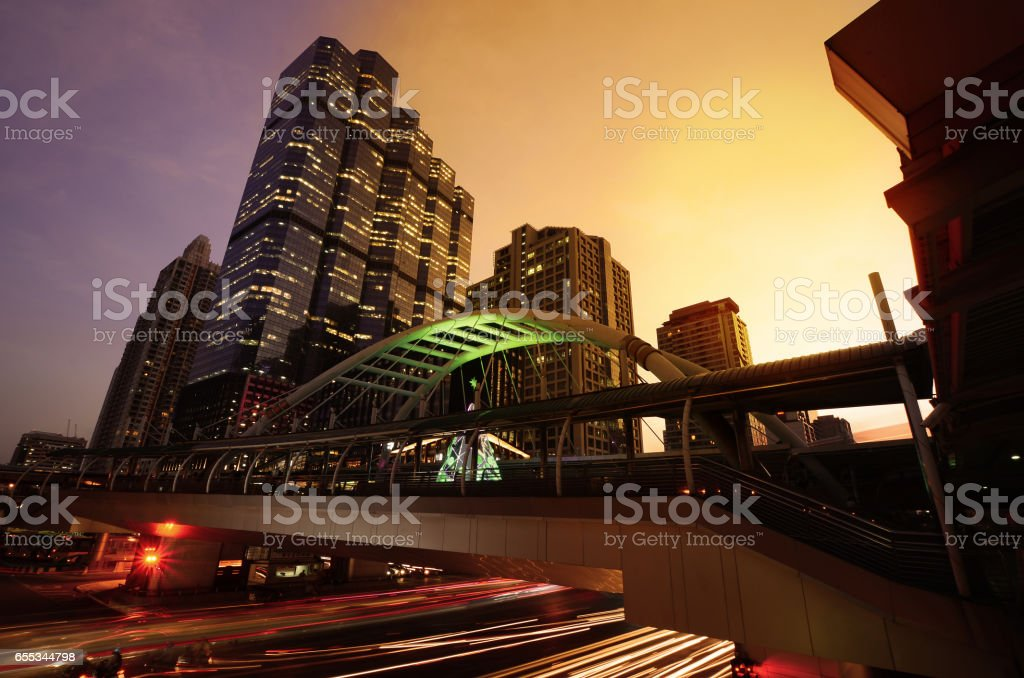 Cityscape Modern building at sunset and cloudy sky.Traffic in the business district The Skytrain station Chong Nonsi,Bangkok,Thailand stock photo